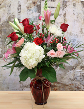 mixed love colours bouquet in red vase