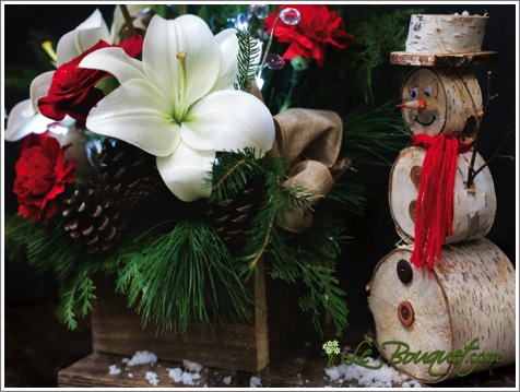 Enchanted forest snowman holiday arrangement from Le Bouquet