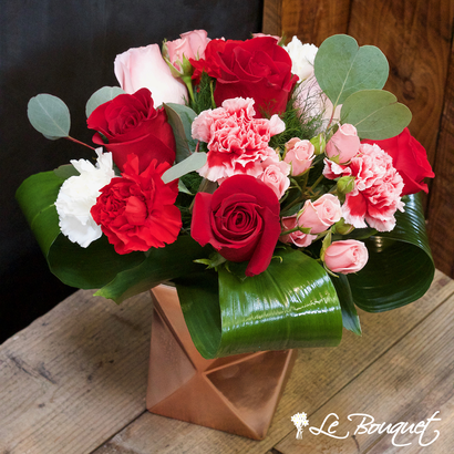 Roses and Carnations in a Rose Gold vase at your Montreal Florist